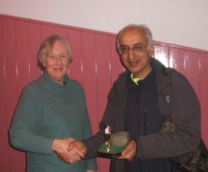 Judy presenting Amjad with trophy
