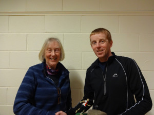 Judy presenting the Club Championships trophy to Keith